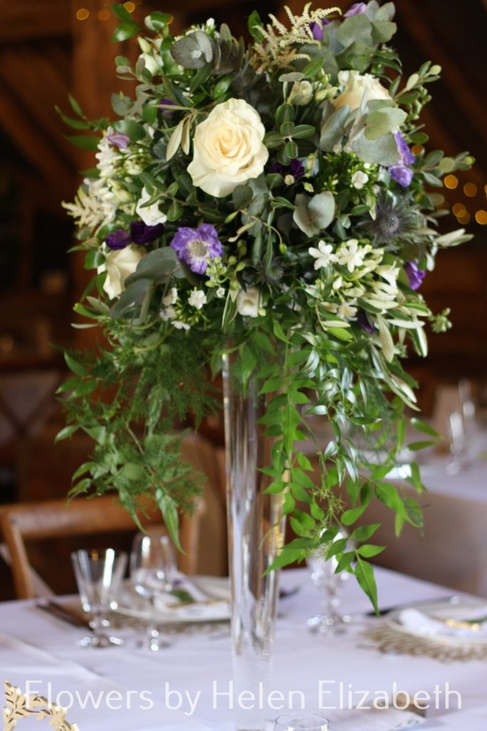 A picture containing table, flower, vase at Silchester Farm