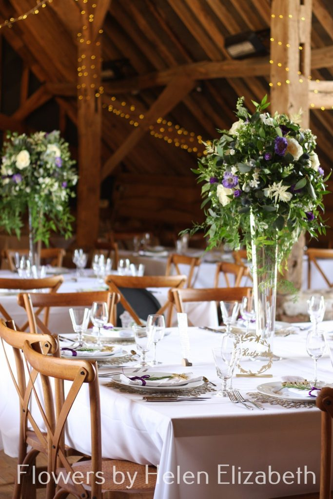 A picture containing table, chair, dining, wedding flowers at Silchester Farm